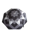 Luxury slim umbrella with stunning monochrome canopy design, elegant black frame and striking gold handle by David David, a fashion accessories brand and print studio based in London England, specialising in bold geometric print