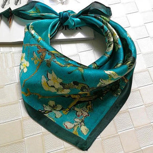 Green Scarf Boutique teal cherry blossom print square bandanna scarf.