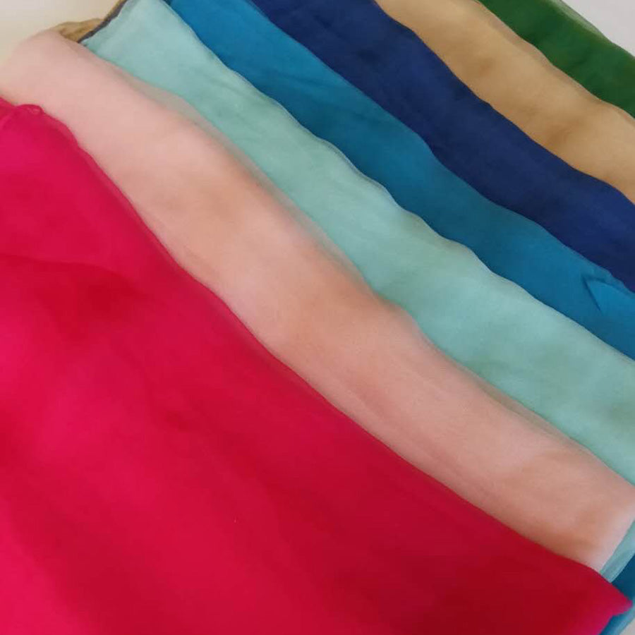 Lightweight chiffon scarves in a rainbow of colours by Green Scarf Boutique.
