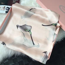 Lightweight pink silk scarf with all over flower print by Green Scarf Boutique.