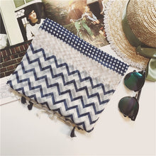 Lightweight summer Green Scarf Boutique navy chevron print scarf.