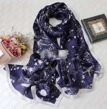 Green Scarf Boutique navy and white start print silk scarf.