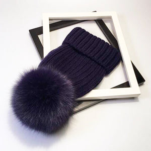 Navy Green Scarf Boutique rib knit beanie with oversized pom-pom.
