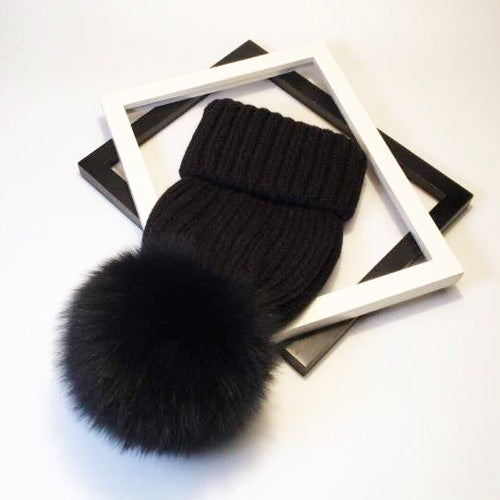 Black Green Scarf Boutique rib knit beanie with oversized pom-pom.