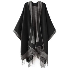 Black shawl cape with fringe detail by Green Scarf Boutique.