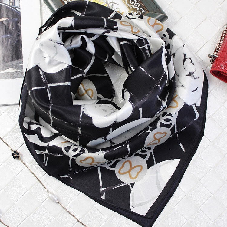 Green Scarf Boutique black and white floral print silk scarf.