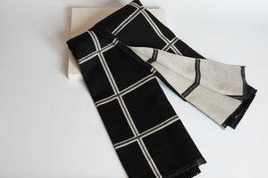 Green Scarf Boutique black and cream grid print blanket scarf.