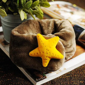 Green Scarf Boutique fleece star kid's neck warmer.