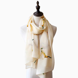 Lightweight beige silk scarf with all over flower print by Green Scarf Boutique.