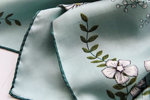 Teal and mint silk scarf with fantasy garden print.