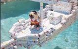 This TikTok Of A Dog Sitting In A Boat Made Of White Claw Boxes And Cans Is Incredible