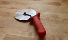 "4"" pizza cutter wheel - The 4"" pizza cutter wheel is the main tool used for portioning a freshly baked pizza pie."