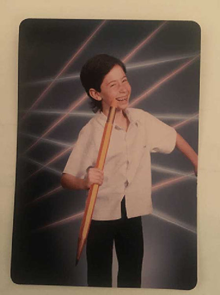 strange kid with giant pencil and lasers