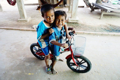Cambodian boys and their bike