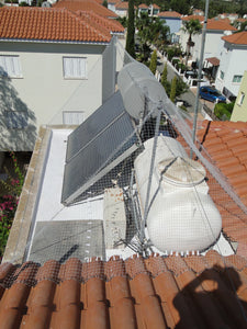 Stopping Pigeons, Sparrows or Starlings Accessing Flat Roof With Specialist Bird Netting Fixed Over Typical Cyprus Roof Hot Water Tank with One Or Two Solar Panels