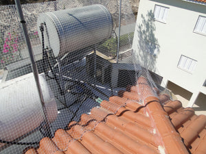 Flat Roof Complete Pigeon, Sparrow or Starling Bird Netting Solution Fixed Over Typical Cyprus Roof Hot Water Tank with One Or Two Solar Panels