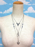 Beads, Cherub, Key and Crown Necklace from Axes Femme