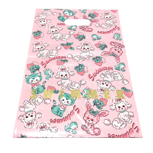 Cats, Dogs and Strawberries Plastic Shopping Bag (M) in Pink from SWIMMER