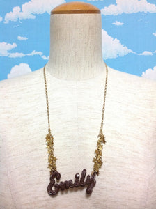 Cream Logo Necklace in Brown from Emily Temple Cute