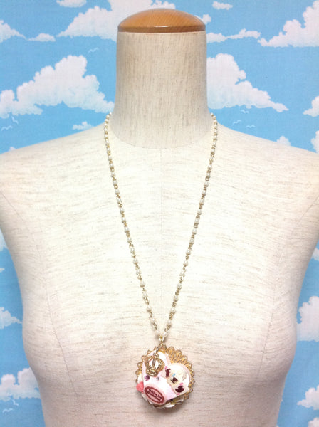 Crown Cake Necklace in Pink from Chelsea