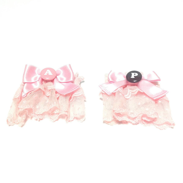 Polka Dot Chocolate Button Wrist Cuffs in Pink from Angelic Pretty