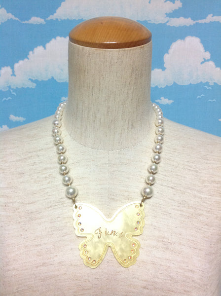 Rhinestone Butterfly Necklace in Ivory from F.I.N.T