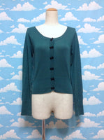 Ribbon Bow Cardigan in Green x Black from F.i.n.t