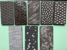 black stoneware clay tile with textured porcelain spot finish - Claire de Lune for Margate Tile Makers - Handmade Tiles // Margate