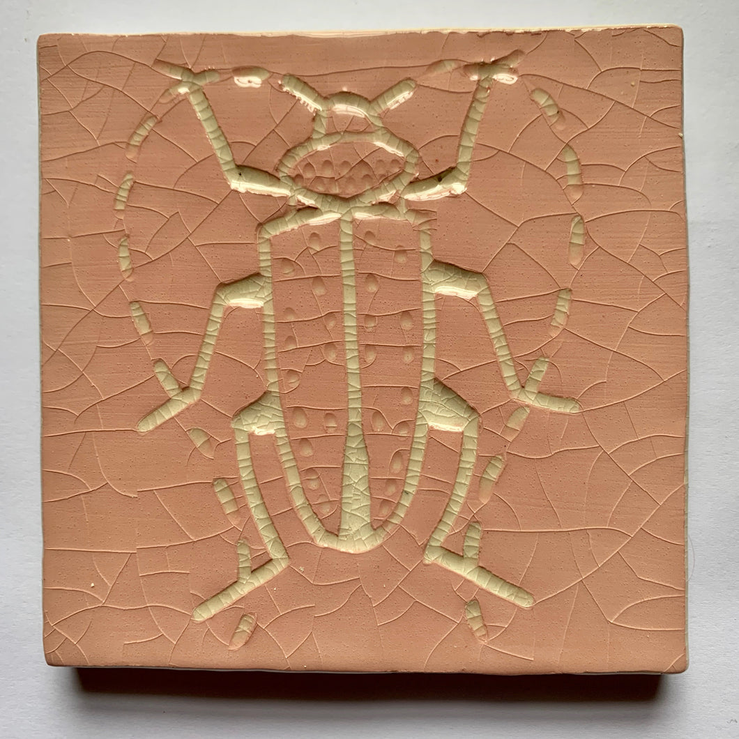 pink and antique white crackle glaze hand-etched bug earthenware ceramic tile - Ema Dennis for Margate Tile Makers - Handmade Tiles // Margate