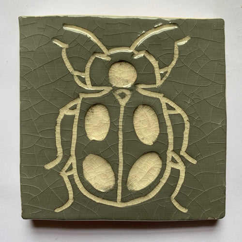 grey and antique white crackle glaze hand-etched bug earthenware ceramic tile - Ema Dennis for Margate Tile Makers - Handmade Tiles // Margate