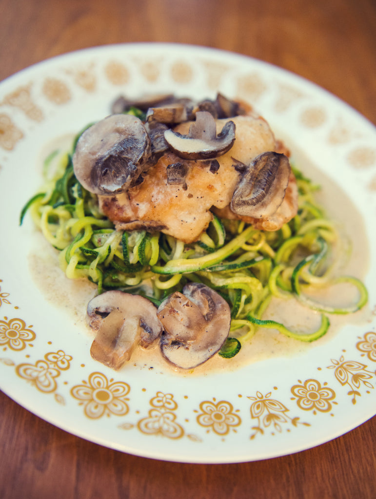 Mushroom Sauce Chicken with Spiral Zucchini is actually really easy but looks super fancy. The kids in our house love the wine sauce lol. This is an amazing gluten free dish and low carb as well. / www.deliciousdesignhouse.com