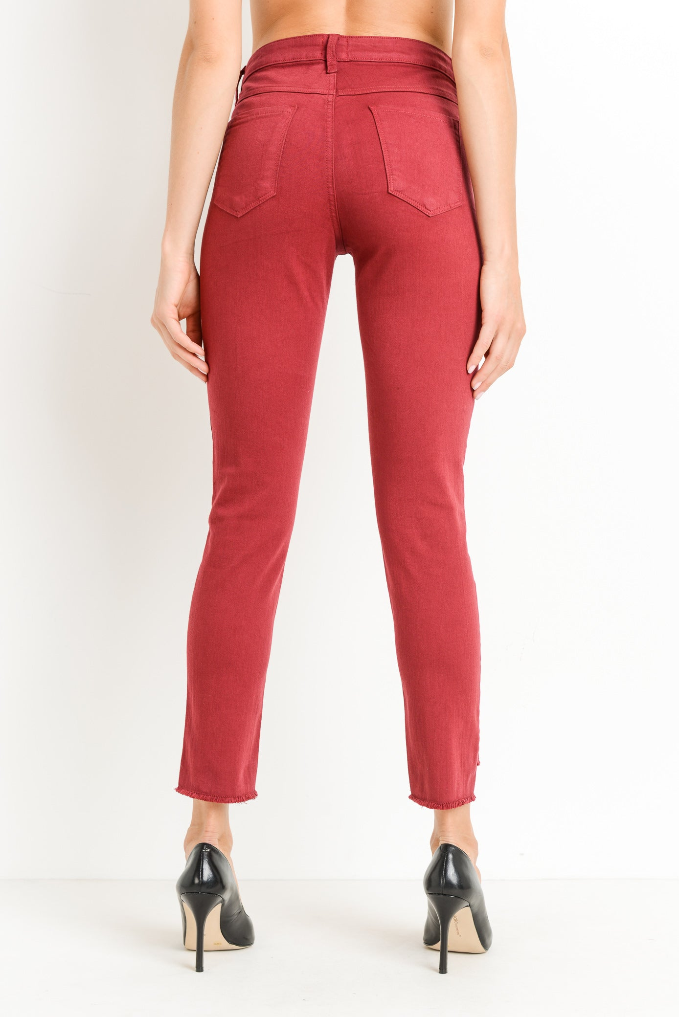 JUST BLACK Crop Fray Step Hem Skinny in Ruby Red