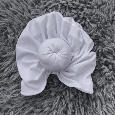littlemissturbans White Head wrap with top knot in the color Pure White littlemissturbans
