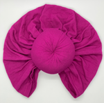 Turban for hair in Magenta with top knot