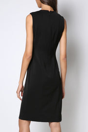 Short black dress with an S-shaped cut-out band with piercings