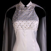 """Constanza"" beaded white mermaid floor-length gown with split cape"