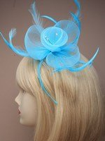 Crystal Innovation-4321 aqua Pastel coloured net and feather crystal centre fascinator on clear comb.