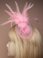 Crystal Innovation-4290 Pink Net Rosette fascinator with feather detail on a clip and brooch pin.
