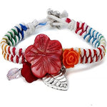 Multi coloured corded bracelet With printed shells and charms