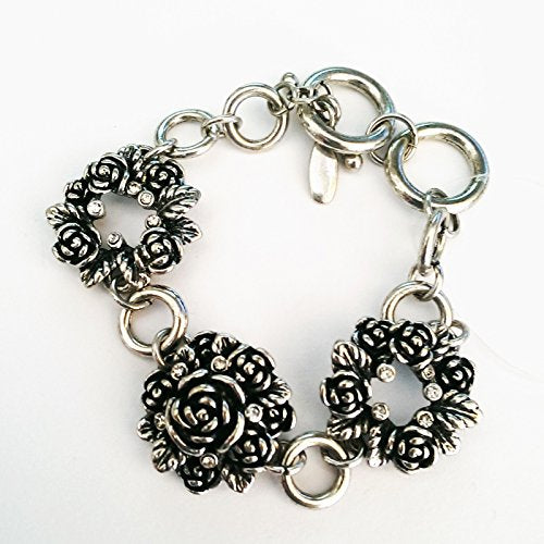 Antique look flower and diamante link bracelet.