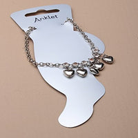 Silver coloured anklet chain with trailing hearts and crystals.