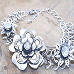 Metal flower bracelet with CZ's. 18cm long + 7cm extension chain.