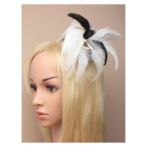 Feather fascinator on a forked clip with brooch pin. In Cream. Style Primrose.