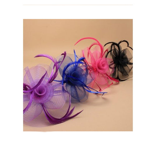 Black Looped net and feather with centre detail fascinator on a narrow black aliceband.