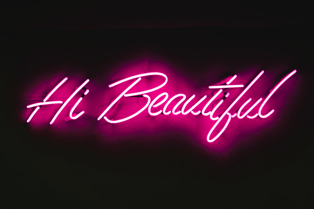 "pink neon sign that says ""Hi Beautiful"""