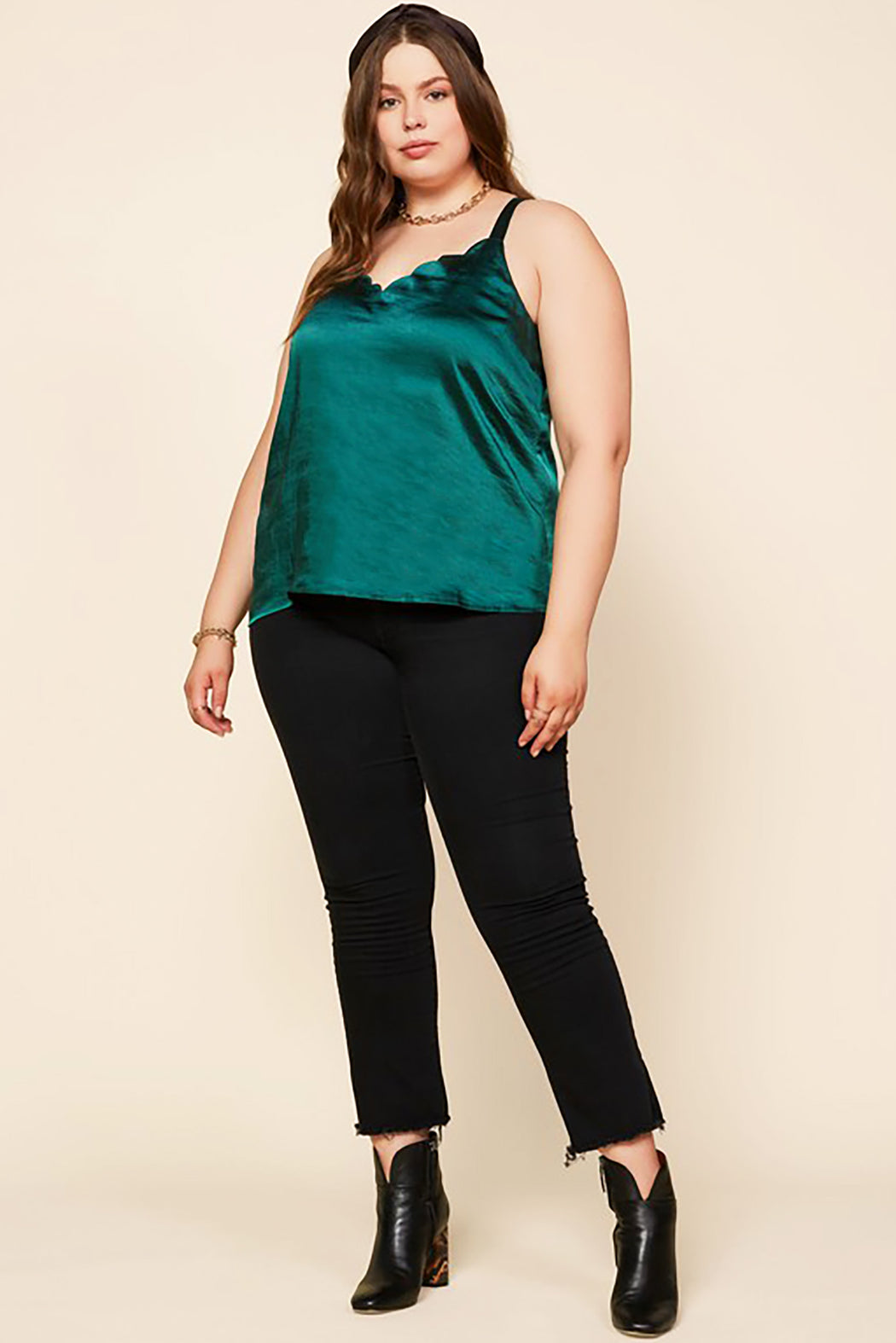 Belle and Broome Joy satin scalloped cami in emerald green on model with black jeans and black boots, full outfit view