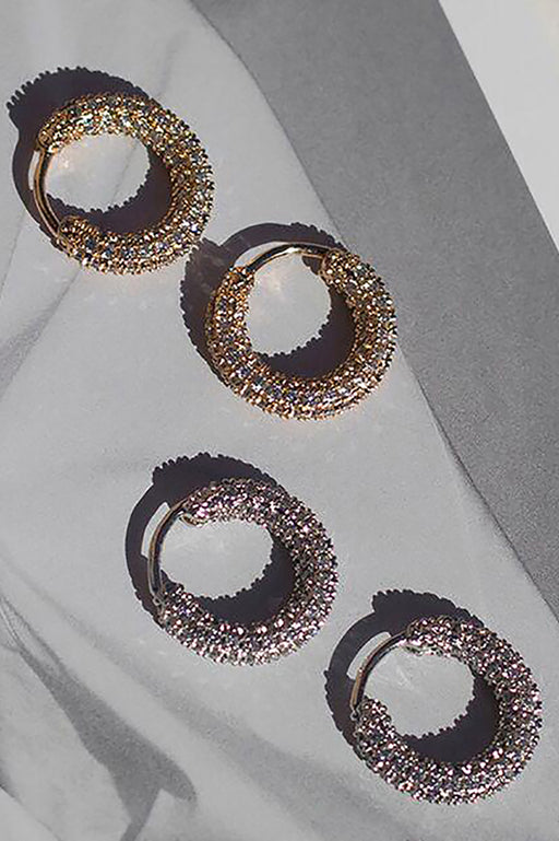 Luv AJ Pave Amalfi Huggies hoop earrings gold and silver flat on grey background