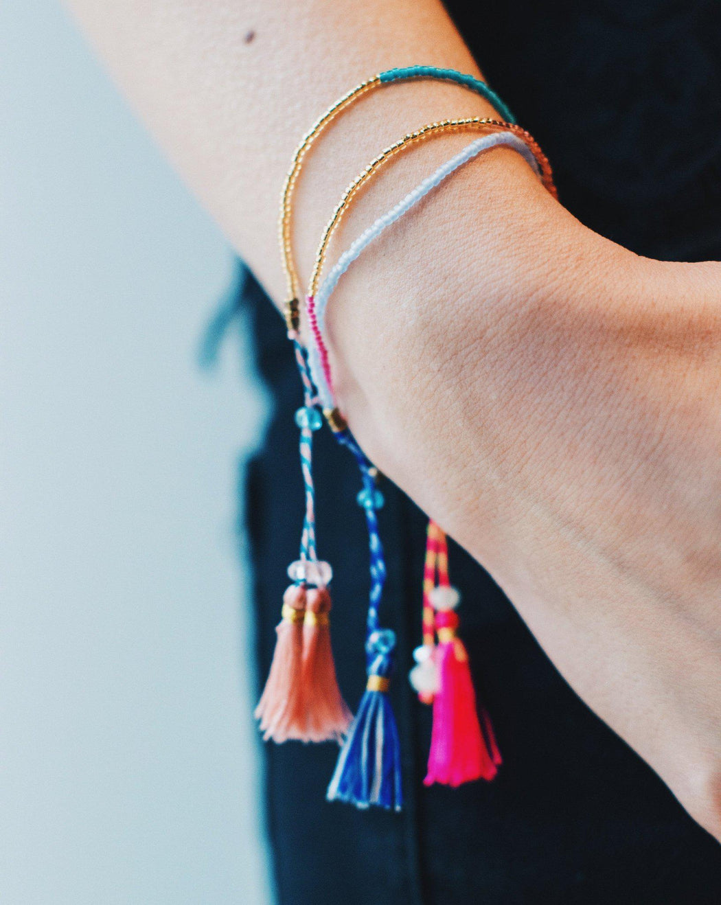 Carnivale beaded tassel bracelets hanging on wrist