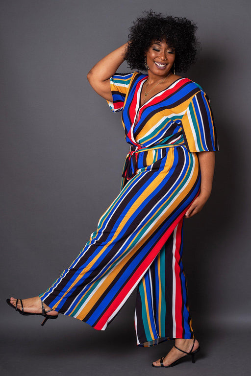 Havana Colorful Stripe Wrap-Front Jumpsuit- Model kicking leg up to show wide leg pant