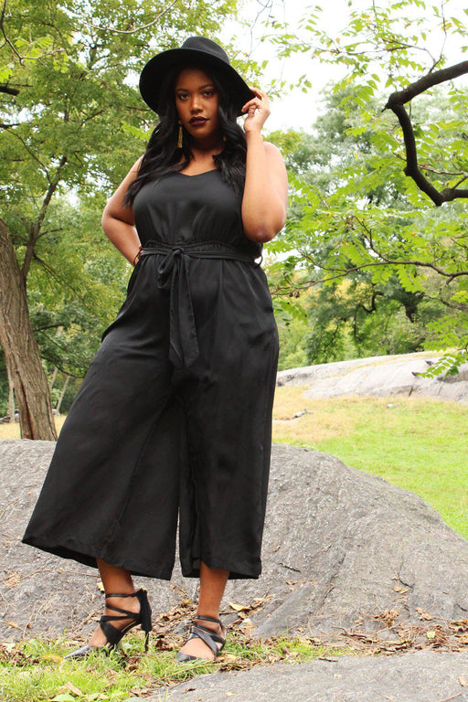 Joanna wide leg black jumpsuit on model front view wearing hat in park